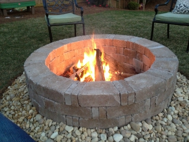 Picture of Lava Rock For Fire Pit Rumblestone Firepit With River Stone Surround And Red Lava Rock