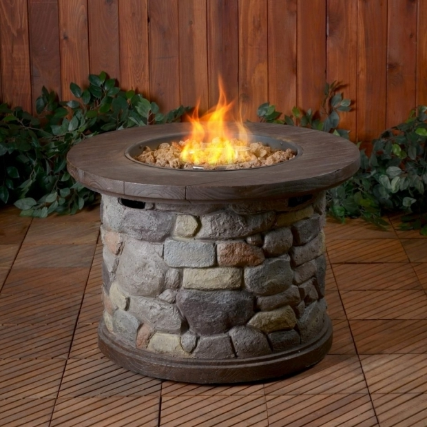 Picture of Sojoe Fire Pit Tabletop Fire Pit Made Smaller Stones As Burning Material Is Added